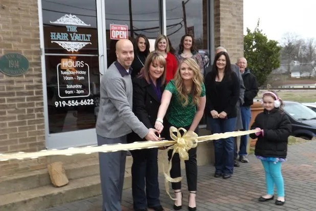 Mayor Flowers along with Jessica L Stapleton and the crew cut the ribbon with Town Board members Larry Wiggins and Graham Stallings joining them - Jessica's daughter helped hold the ribbon!