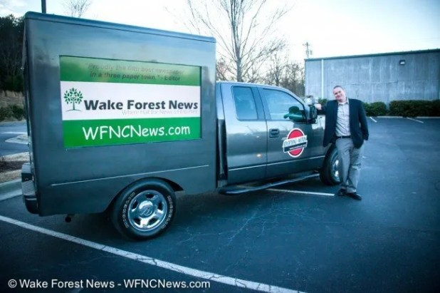 Justin Graney stands with his one-of-a-kind mobile advertising truck with one amazing ad on it.