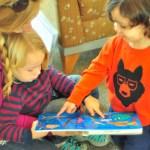 children sitting in mom's lap reading books t WFoL.org