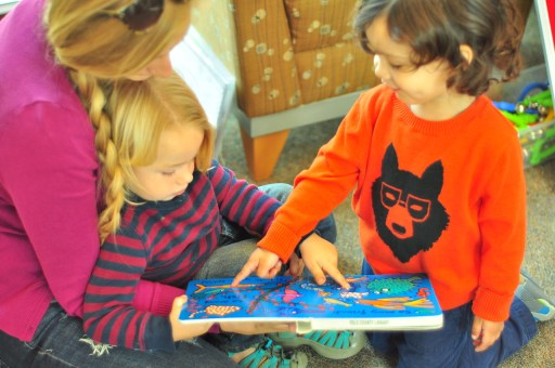 Children enjoying looking at books at the Winters Community Library