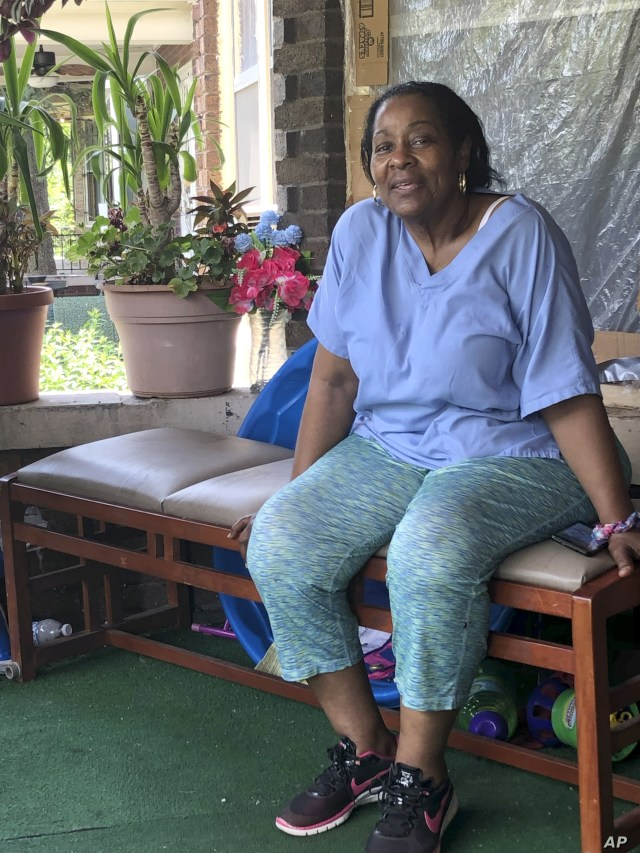 Deloris Knight of Detroit, Mich., sits on her front porch, Wednesday, July 17, 2019, as she prepares for the heat wave that will descend upon Detroit and a wide section of the Midwest. Knight said she will keep the heat out of her Eastside Detroit…