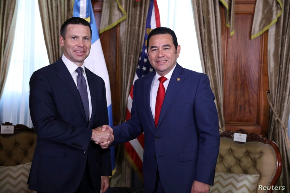 U.S. Department of Homeland Security (DHS) acting Secretary Kevin McAleenan and Guatemalan President Jimmy Morales shake hands during a photo opportunity during before a bilateral meeting in Guatemala City