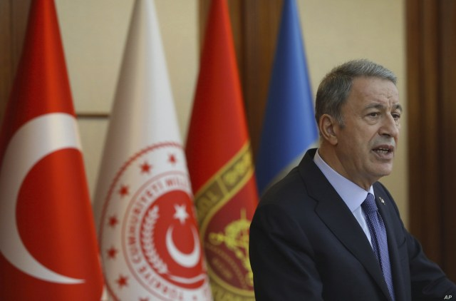 FILE - Turkey's Defense Minister Hulusi Akar speaks to a group of reporters in Ankara, Turkey, May 21, 2019.
