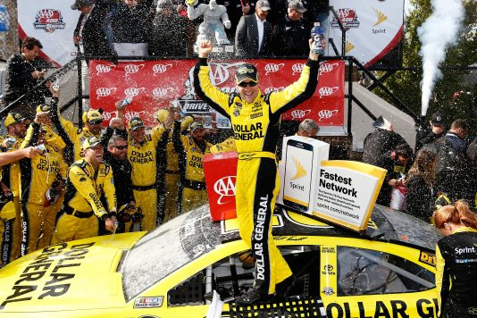 DOVER, DE - MAY 15:  Matt Kenseth, driver of the #20 Dollar General Toyota, celebrates in Victory Lane after winning the NASCAR Sprint Cup Series AAA 400 Drive for Autism at Dover International Speedway on May 15, 2016 in Dover, Delaware.  (Photo by Jeff Zelevansky/NASCAR via Getty Images)