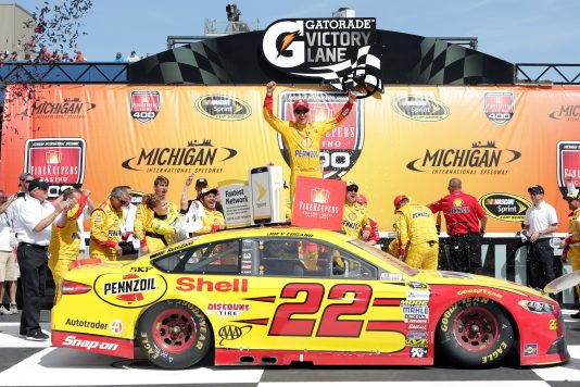 BROOKLYN, MI - JUNE 12:  Joey Logano, driver of the #22 Shell Pennzoil Ford, celebrates in victory lane after winning the NASCAR Sprint Cup Series FireKeepers Casino 400 at Michigan International Speedway on June 12, 2016 in Brooklyn, Michigan.  (Photo by Kena Krutsinger/Getty Images )