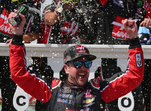 """LONG POND, PA - JUNE 06:  Kurt Busch, driver of the #41 Monster Energy/Haas Automation Chevrolet, celebrates in Victory Lane after winning the NASCAR Sprint Cup Series Axalta """"We Paint Winners"""" 400 at Pocono Raceway on June 6, 2016 in Long Pond, Pennsylvania.  (Photo by Sarah Crabill/Getty Images)"""