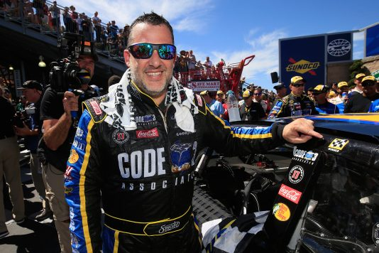 SONOMA, CA - JUNE 26:  Tony Stewart, driver of the #14 Code 3 Assoc/Mobil 1 Chevrolet, applies a Winner Sticker in victory lane after winning the NASCAR Sprint Cup Series Toyota/Save Mart 350 at Sonoma Raceway on June 26, 2016 in Sonoma, California.  (Photo by Chris Trotman/NASCAR via Getty Images)