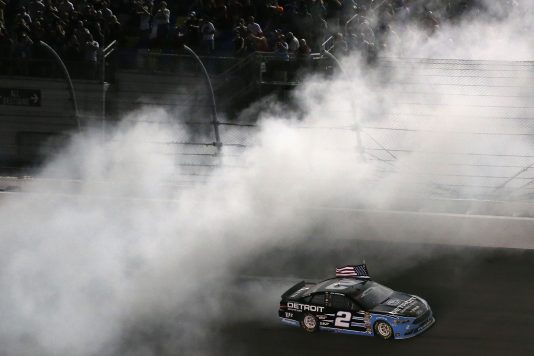 DAYTONA BEACH, FL - JULY 02: Brad Keselowski, driver of the #2 Detroit Genuine Parts Ford, celebrates with a burnout after taking the checkered flag in the NASCAR Sprint Cup Series Coke Zero 400 Powered By Coca-Cola at Daytona International Speedway on July 2, 2016 in Daytona Beach, Florida.  (Photo by Matt Sullivan/Getty Images) *** Local Caption *** Brad Keselowski