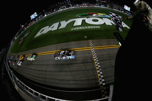 DAYTONA BEACH, FL - JULY 02:  Brad Keselowski, driver of the #2 Detroit Genuine Parts Ford, takes the checkered flag to win the NASCAR Sprint Cup Series Coke Zero 400 Powered By Coca-Cola at Daytona International Speedway on July 2, 2016 in Daytona Beach, Florida.  (Photo by Sarah Crabill/NASCAR via Getty Images) *** Local Caption *** Brad Keselowski