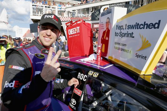 WATKINS GLEN, NY - AUGUST 07:  Denny Hamlin, driver of the #11 FedEx Freight Toyota, affixes the winner's decal to his car in Victory Lane after winning the NASCAR Sprint Cup Series Cheez-It 355 at Watkins Glen International on August 7, 2016 in Watkins Glen, New York.  (Photo by Jonathan Ferrey/NASCAR via Getty Images)