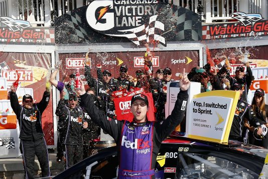 WATKINS GLEN, NY - AUGUST 07:  Denny Hamlin, driver of the #11 FedEx Freight Toyota, celebrates in victory lane after winning the NASCAR Sprint Cup Series Cheez-It 355 at Watkins Glen International on August 7, 2016 in Watkins Glen, New York.  (Photo by Jonathan Ferrey/NASCAR via Getty Images)