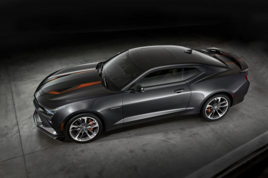"""The 2017 Camaro 50th Anniversary Special Edition is available summer 2016 on 2LT and 2SS coupe or convertible models. The Special Edition features a Nightfall Gray exterior, unique 20"""" wheels and center caps, orange stripe package and a black interior with suede accents and orange stitching. Distinct 50th anniversary badging treatment is featured on seatbacks, the steering wheel badge and illuminated sill plates. For the 2017 model year, every Camaro built will feature a special 50th Anniversary badge on the steering wheel."""