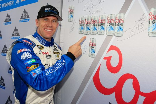 LOUDON, NH - SEPTEMBER 23:  Carl Edwards, driver of the #19 Comcast Business Toyota, poses with the Coors Light Pole board after qualifying for the pole position for the NASCAR Sprint Cup Series Bad Boy Off Road 300 at New Hampshire Motor Speedway on September 23, 2016 in Loudon, New Hampshire.  (Photo by Chris Trotman/NASCAR via Getty Images)