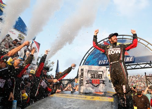 DOVER, DE - OCTOBER 02:  Martin Truex Jr., driver of the #78 Furniture Row/Denver Mattress Toyota, celebrates in Victory Lane after winning the NASCAR Sprint Cup Series Citizen Solider 400 at Dover International Speedway on October 2, 2016 in Dover, Delaware.  (Photo by Matt Sullivan/Getty Images)