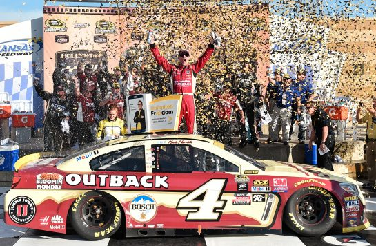 KANSAS CITY, KS - OCTOBER 16:  Kevin Harvick, driver of the #4 Outback Chevrolet, celebrates in Victory Lane after winning the NASCAR Sprint Cup Series Hollywood Casino 400 at Kansas Speedway on October 16, 2016 in Kansas City, Kansas.  (Photo by Jason Hanna/Getty Images)