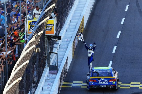 MARTINSVILLE, VA - OCTOBER 30:  Jimmie Johnson, driver of the #48 Lowe's Chevrolet, celebrates with the checkered flag after winning the NASCAR Sprint Cup Series Goody's Fast Relief 500 at Martinsville Speedway on October 30, 2016 in Martinsville, Virginia.  (Photo by Daniel Shirey/Getty Images)