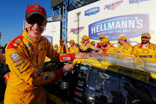 TALLADEGA, AL - OCTOBER 23:  Joey Logano, driver of the #22 Shell Pennzoil Ford, poses with the winner's decal in Victory Lane after winning the NASCAR Sprint Cup Series Hellmann's 500 at Talladega Superspeedway on October 23, 2016 in Talladega, Alabama.  (Photo by Jonathan Ferrey/NASCAR via Getty Images)