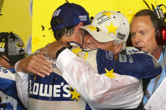 HOMESTEAD, FL - NOVEMBER 20:  Jimmie Johnson, driver of the #48 Lowe's Chevrolet, celebrates with team owner Rick Hendrick in Victory Lane after winning the NASCAR Sprint Cup Series Ford EcoBoost 400 and the 2016 NASCAR Sprint Cup Series Championship at Homestead-Miami Speedway on November 20, 2016 in Homestead, Florida. Johnson wins a record-tying 7th NASCAR title.  (Photo by Sarah Crabill/Getty Images)
