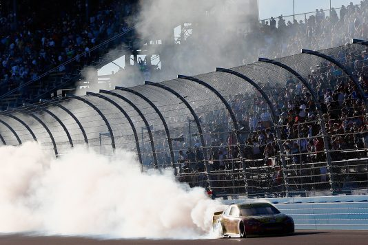 AVONDALE, AZ - NOVEMBER 13:  Joey Logano, driver of the #22 Shell Pennzoil Ford, celebrates with a burnout after winning the NASCAR Sprint Cup Series Can-Am 500 at Phoenix International Raceway on November 13, 2016 in Avondale, Arizona.  (Photo by Jonathan Ferrey/Getty Images)
