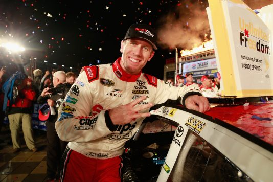 FORT WORTH, TX - NOVEMBER 06:  Carl Edwards, driver of the #19 Sport Clips Toyota, poses in Victory Lane with the winner's decal after winning the rain-shortened NASCAR Sprint Cup Series AAA Texas 500 at Texas Motor Speedway on November 6, 2016 in Fort Worth, Texas.  (Photo by Matt Sullivan/NASCAR via Getty Images)