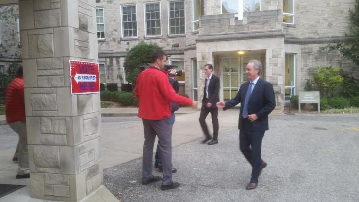 Mayor Greg Fischer walks into his polling place on Election Day 2016.