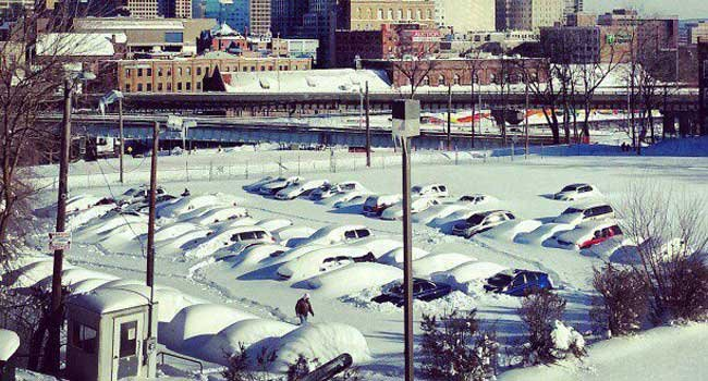 © Cars buried under snow in downtown Hartford.