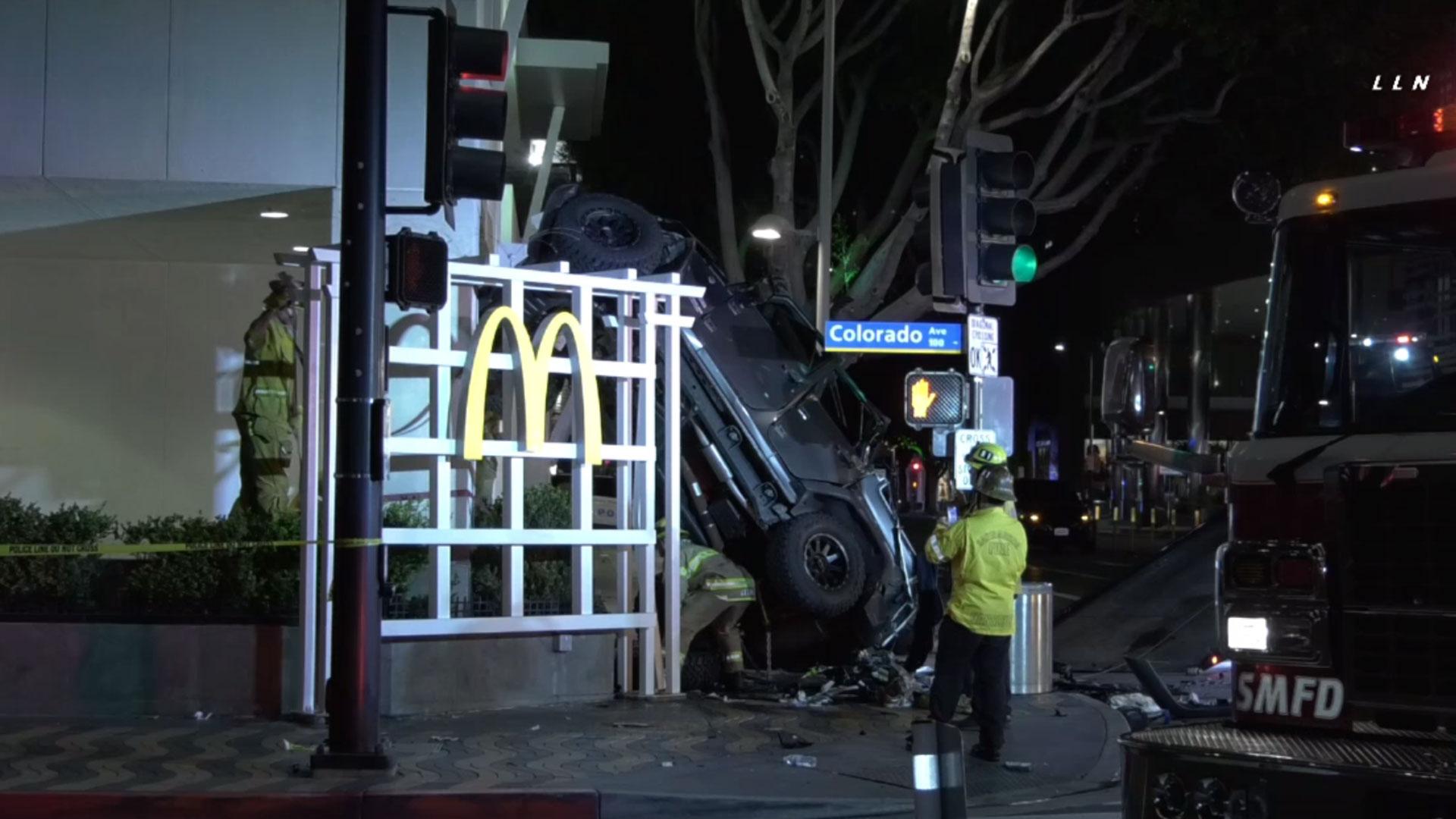 Jeep plunges off parking garage
