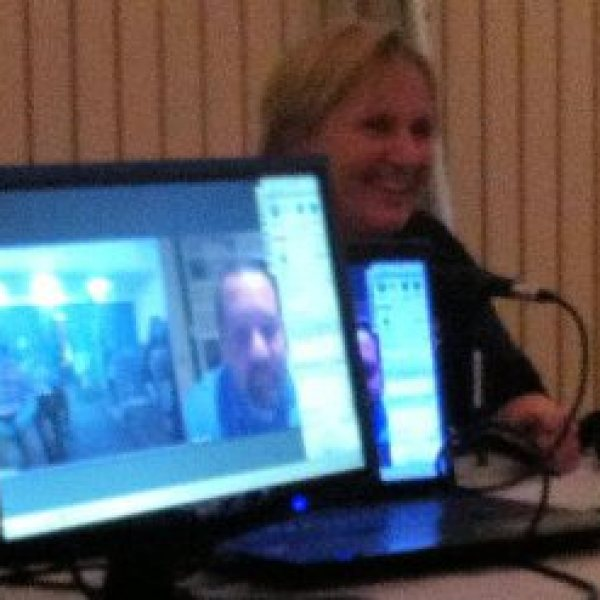 Sandy Colbert in background