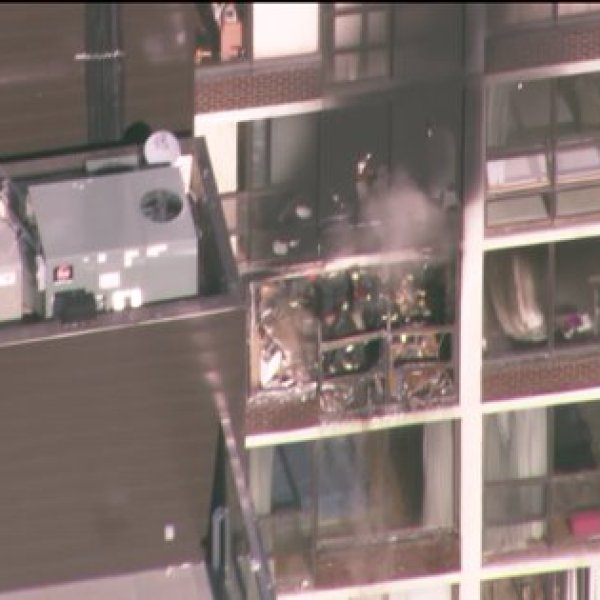 2-11 alarm fire engulfs North Side high rise