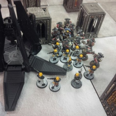 Imperial Guardsmen engage Blood Angels Death Company Space Marines. the close combat goes VERY badly for the guardsmen...