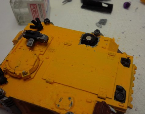 Concealing some strong magnets within the hull of the rhino.