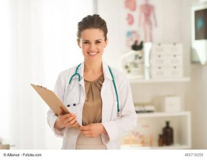 Portrait of happy medical doctor woman with clipboard