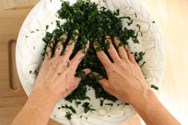 """Mediterranean Kale salad getting a """"massage""""."""