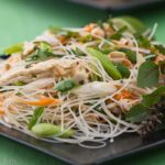Get the recipe for a delicious summer salad! Thai rice noodle salad with chicken, cilantro and peanuts. Light and healthy summer dinner.