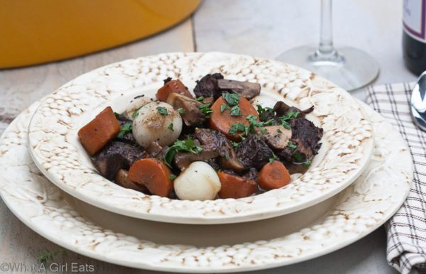 Boeuf bourguignon, also known as burgundy beef, is a rich, hearty beef stew. It is the perfect Sunday supper or meal for any special occasion.   @whatagirleats