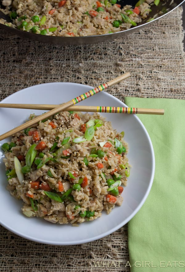 Pork fried rice is a flavorful Asian dish, packed with tender rice, bite sized pieces of pork, and crisp vegetables. Making it at home is incredibly quick and easy to do! | Recipe from What a Girl Eats