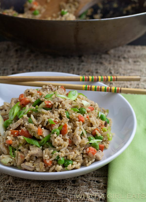 Pork fried rice is a flavorful Asian dish, packed with tender rice, bite sized pieces of pork, and crisp vegetables. Making it at home is incredibly quick and easy to do! | From @whatagirleats