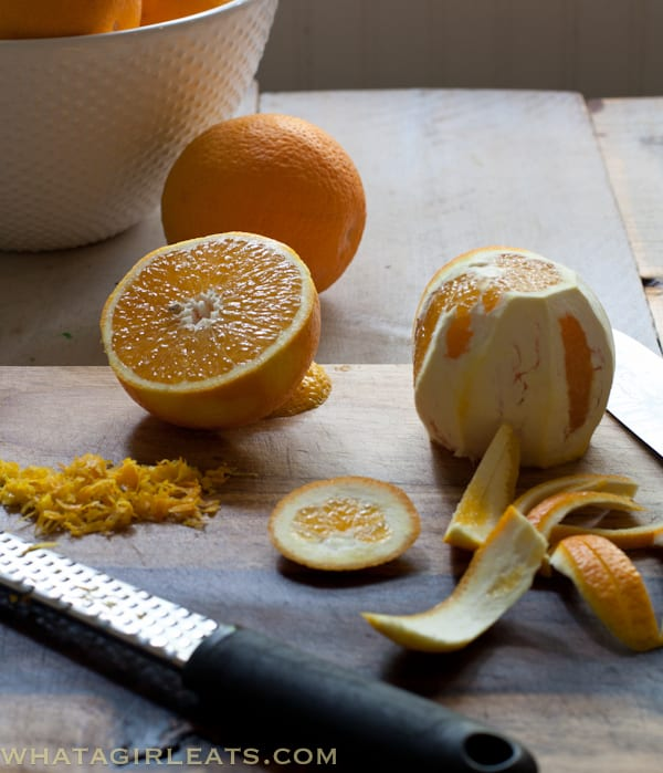 Zest the one orange, cut the peel off the second. Juice oranges to get 3/4 cup.