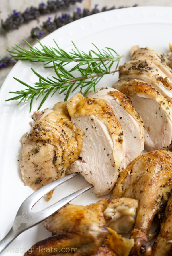 This French Roasted Chicken is rubbed with herbs and butter and stuffed with a lemon, to make the moistest and easiest chicken ever!