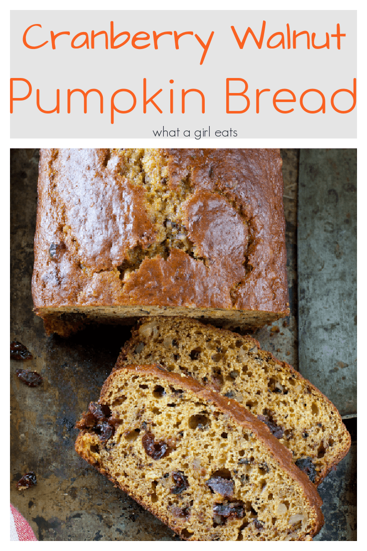 Moist and tender pumpkin bread with cranberries and walnuts.