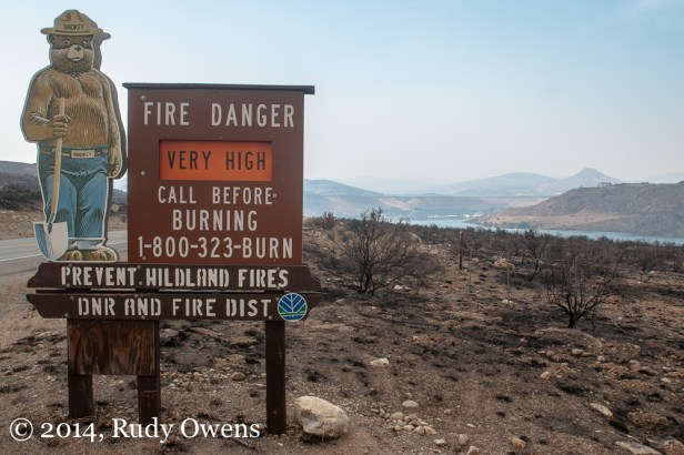 The air is thick with smoke in the Columbia River basin, north from Wenatchee to the Canadian border. This was taken near the fire damaged town of Pateros on Highway 97.