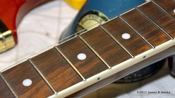 A light coat of Mineral Oil rubbed in to seal and condition the fretboard.