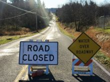 road closed signs above graveline crossing silver creek between sunset and slater shoulder erosion after heavy local rain 2017-12-20