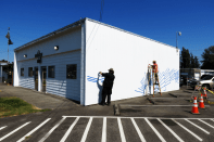FAC member kyle deming and artist todd bruce begin laying out the pattern for a mural on the city hall annex 20118-08-09