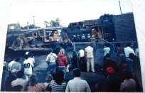 crowd watches as workers remove train cars from Ferndale ConTel building 2 1979-09 photo Ron Willand