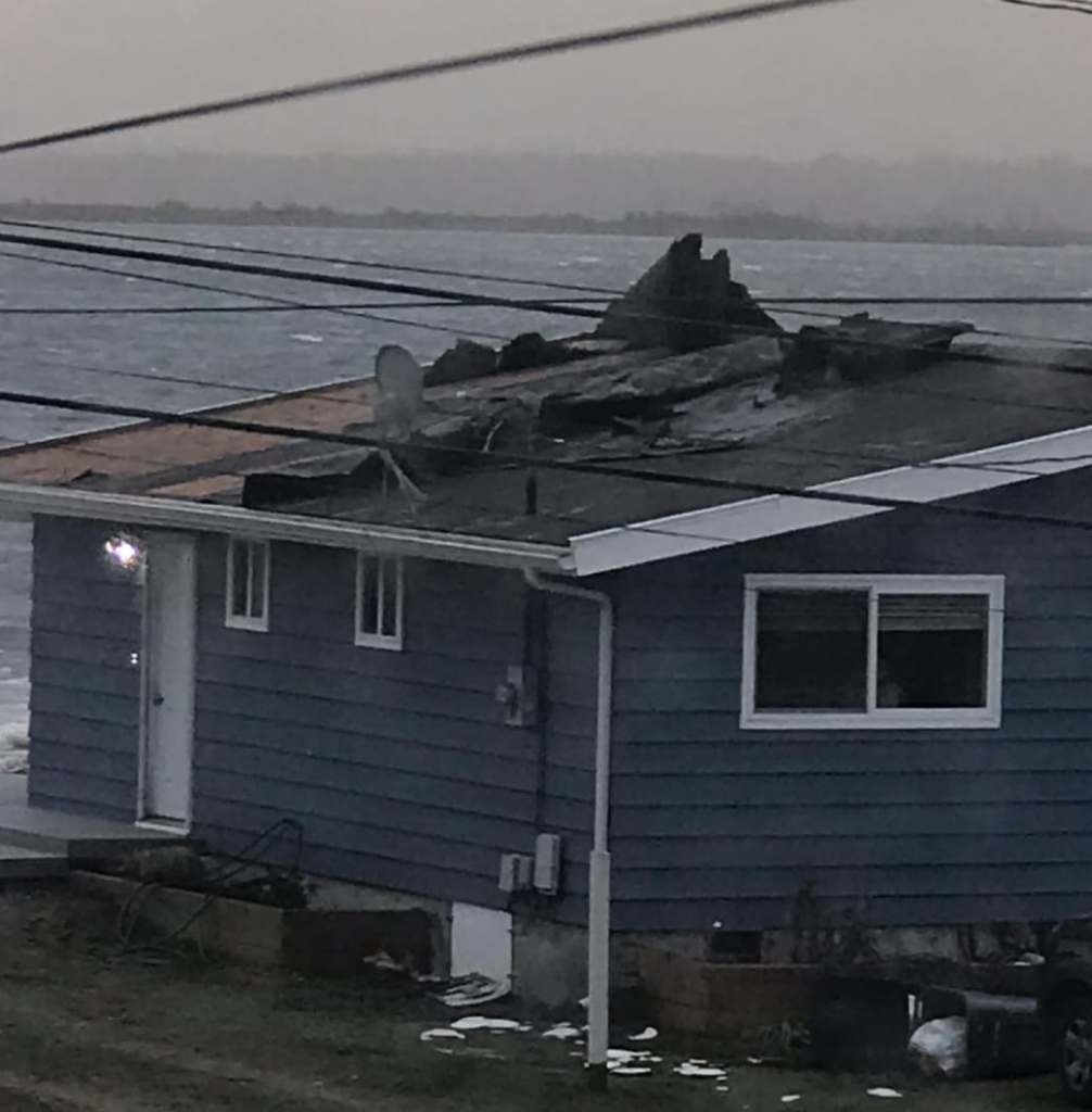 Roof damage in the 4200 block of Saltspring Drive after a windstorm with 70mph gusts (February 9, 2019). Photo courtesy Sandy Point Watch