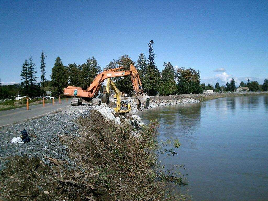 Corp of Engineers and their contractors work to repair the Nooksack River levee in Ferndale (September 2010). Photo courtesy Ferndale Public Works.