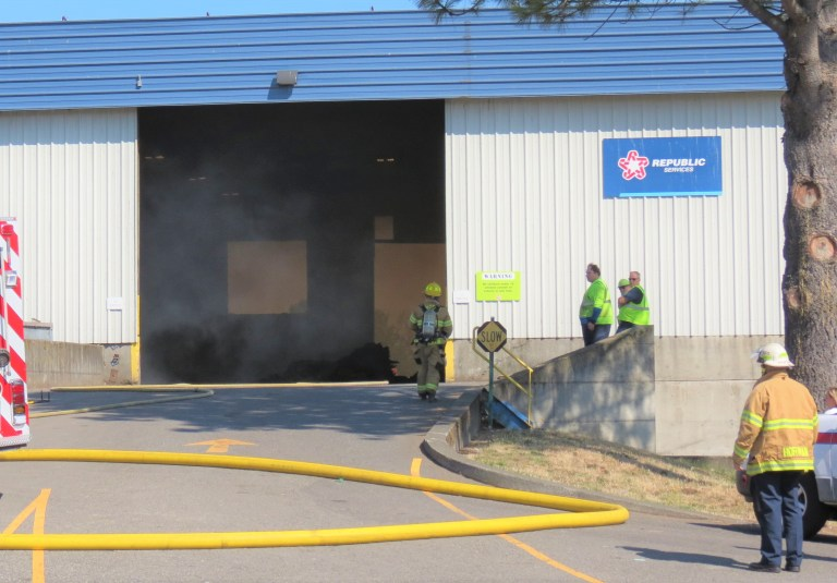 Workers stand by while firefighters from WCFD7 control a fire inside the Republic Services waste disposal center (July 23, 2019). Photo: My Ferndale News