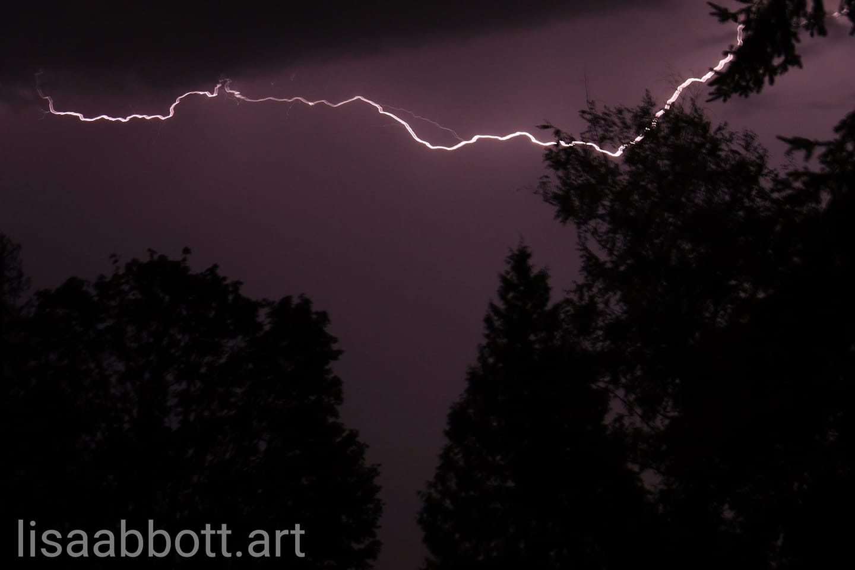 One of many lightning bolts that lit up area skies during a surprise evening thunderstorm (September 7, 2019). Photo courtesy Lisa Abbott of lisaabbott.art