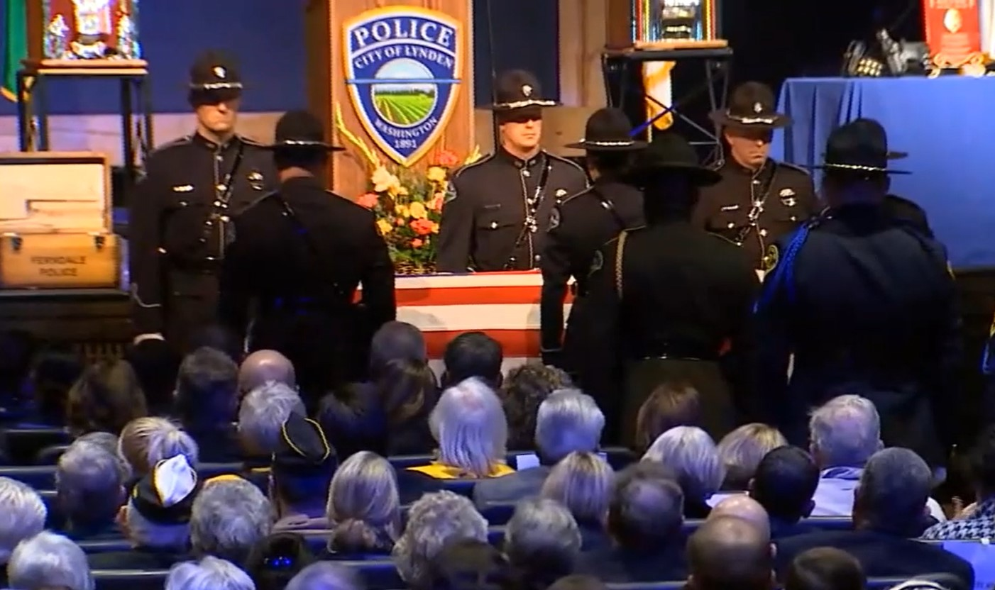 Closing honors during the memorial ceremony for Chief Michael Knapp (November 20, 2019). Image from media pool video courtesy of KING5